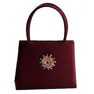 Handbag with brooch