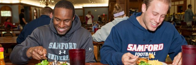 2-Male-Students-Eating-in-the-Caf-Header