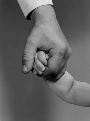 Holding your sons hand someday turns into him holding on to you. leslieannetarabella.com
